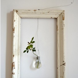Rising Design Star - An empty frame with suspended vase