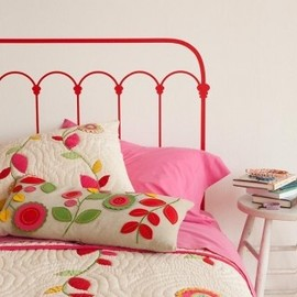 red bed...applique quilt.