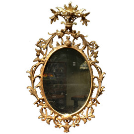 Oval Rococo Mirror, Crested with a Carved Floral Basket