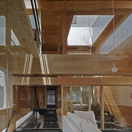 UID Architects - Machi Building, renovated old townhouse has timber boards line walls