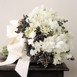 Blue-black privet berries stand out in this rustic bouquet